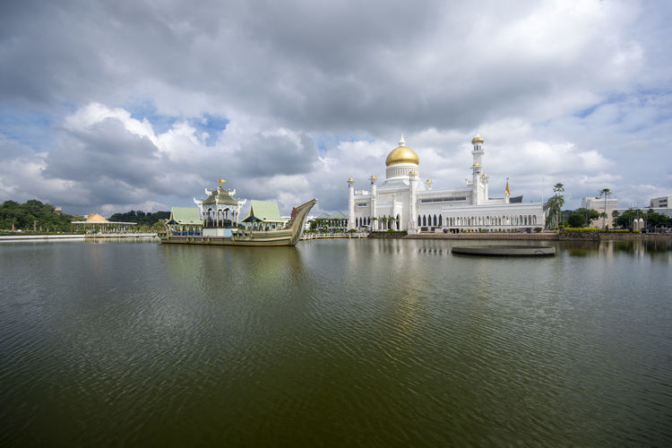 Sultan Omar Ali Saifuddin Mosque at Bandar Seri Begawan, Brunei Darussalam Building Exterior Architecture Sky Cloud - Sky Water Built Structure Travel Destinations Nature Travel Day Dome City Religion Outdoors Building Waterfront Tourism No People Government