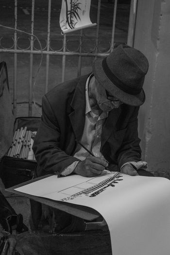 Cap Day Indoors  Lifestyles Men One Person Painter People Real People Sitting Table Vintage Stories From The City