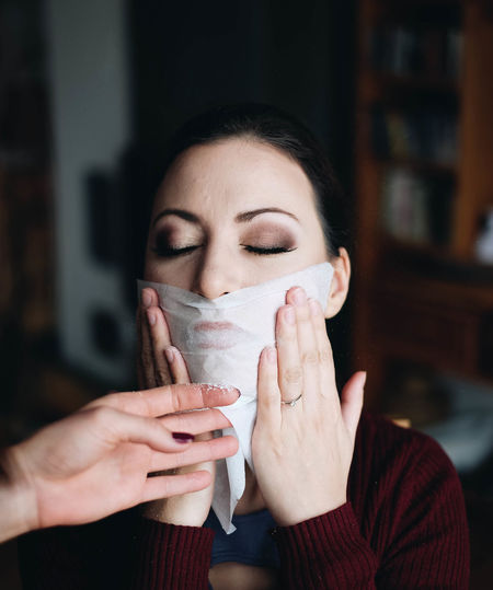 Woman Holding Tissue Paper On Face