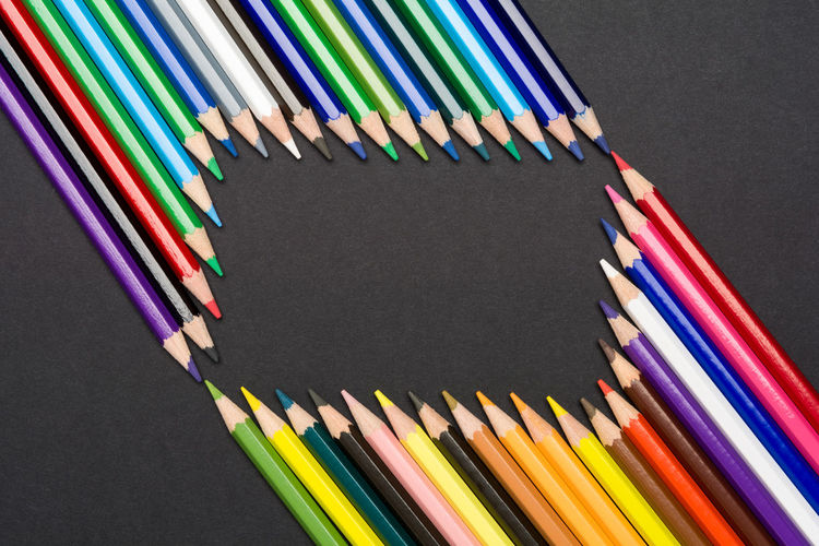 Frame of colored pencils isolated on black cardboard Creativity Imagination Preschool Shape Sketch Arrangement Art Backgrounds Black Background Border Colored Pencil Colorful Crayon Creativity Draw Education Frame Hobby In A Row Inspiration Multi Colored Pattern Pencil School Variation