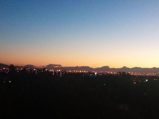 Sunrise - Dawn City Cityscape Mountain Illuminated Urban Skyline Silhouette Sky Mountain Range