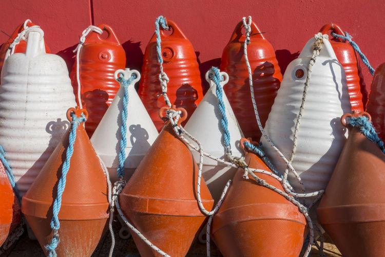 Close-Up Of Multi Colored Buoys