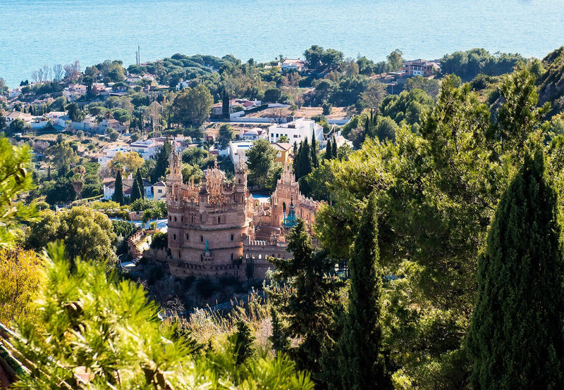 View of the Benalmadena town and Colomares castle. Malaga, Spain Andalucía Architecture Benalmádena, Malaga, Spain Building Exterior Christopher Columbus Cityscape Coast Colomares Castle Costa Del Sol Europe High Angle View Landmark Landscape Malaga Mediterranean Sea Monument No People Outdoors SPAIN Sunny Day Town TOWNSCAPE Travel Destination Travel Destinations Tree