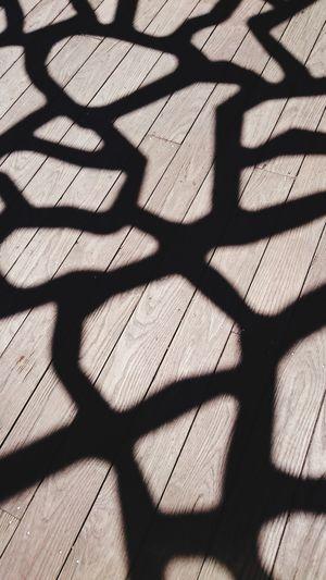 High angle view of shadow on floor