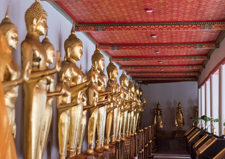 Buddha image of Thailand. Architecture Art And Craft Belief Building Built Structure Ceiling Craft Gold Colored Human Representation In A Row Male Likeness No People Ornate Place Of Worship Religion Representation Sculpture Spirituality Statue Travel Destinations