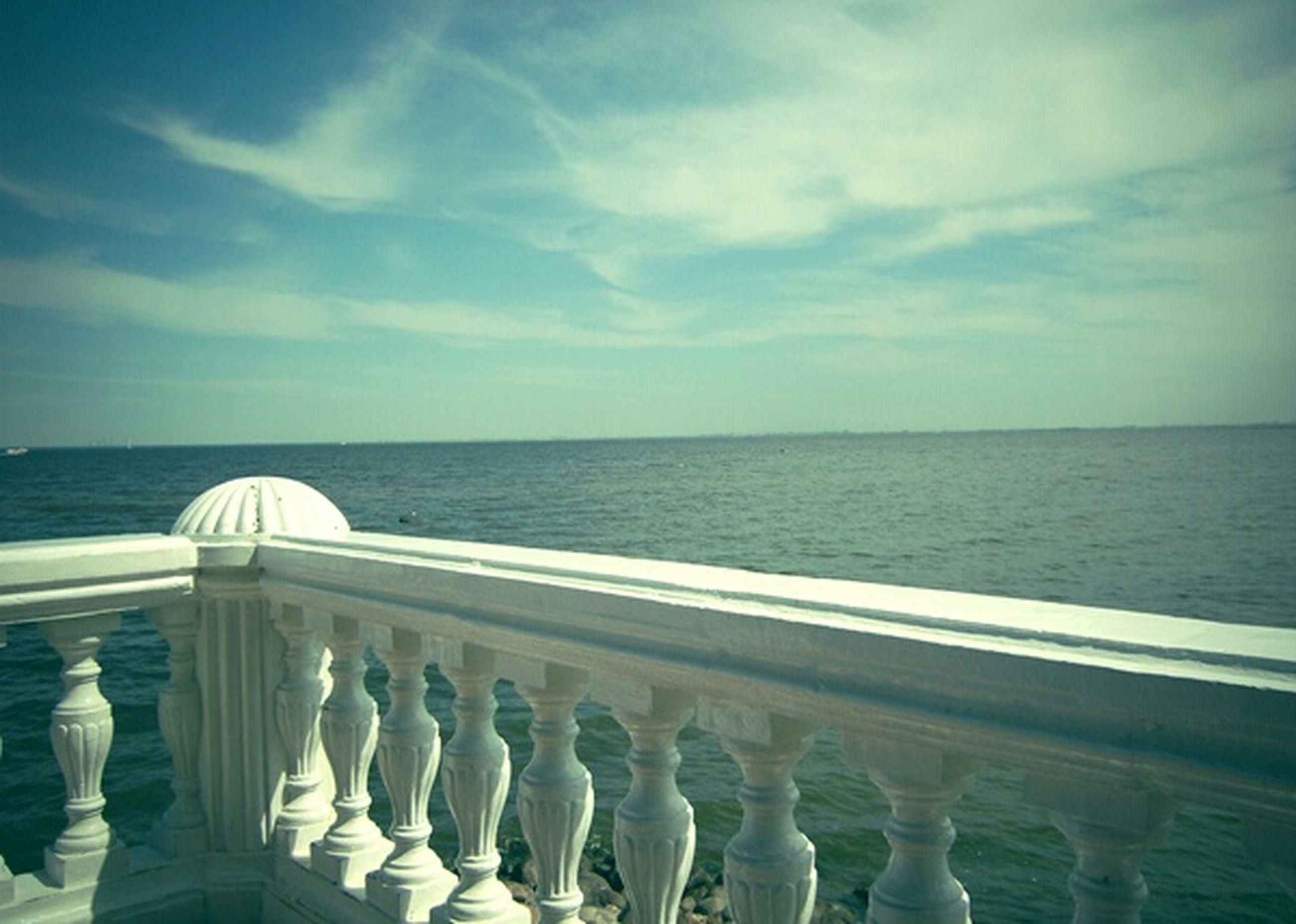 sea, horizon over water, water, sky, railing, scenics, tranquil scene, beauty in nature, tranquility, cloud - sky, nature, blue, cloud, idyllic, beach, day, seascape, pier, no people, outdoors
