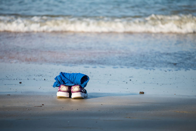 Shoes and shirt at beach. holiday summer background