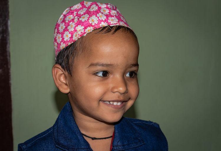 Close-up of smiling boy wearing cap