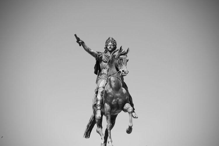 Low angle view of statue against white background