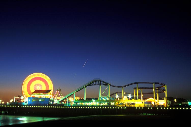 Illuminated Amusement Park At Night