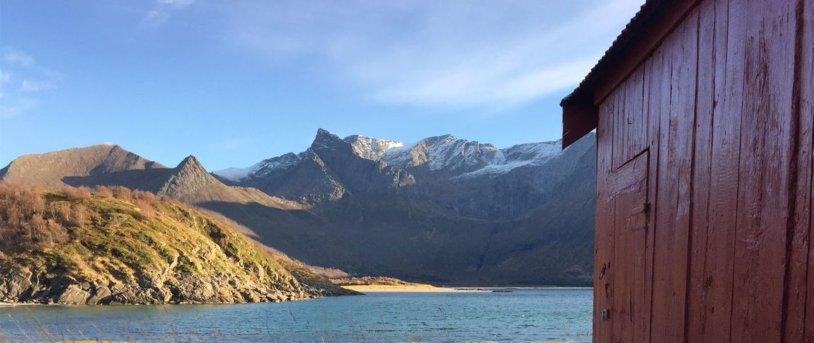 EyeEm Selects Boathouses Scenics Mountain Tranquil Scene Beauty In Nature Red Color Sea Built Structure