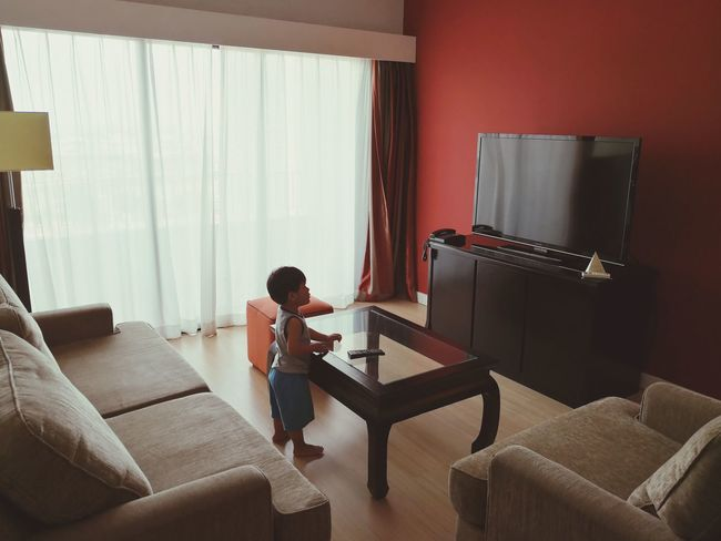 Blank Screen Stare Children Only Lonely Figuring It Out Childhood Wireless Technology Full Length Living Room Childhood Technology Domestic Life Sitting Curtain Learning