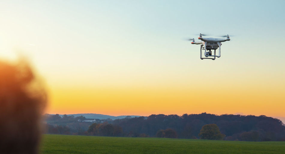 Drone  Air Vehicle Camera - Photographic Equipment Clear Sky Drone  Dronephotography Environment Field Flying Grass Landscape Media Equipment Mid-air Mode Of Transportation Mountain Nature Outdoors Photography Themes Sky Sunset Surveillance Technology Transportation Uav