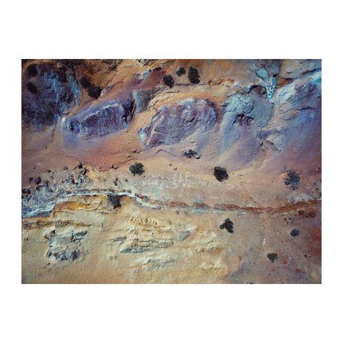 Digital composite image of multi colored rock