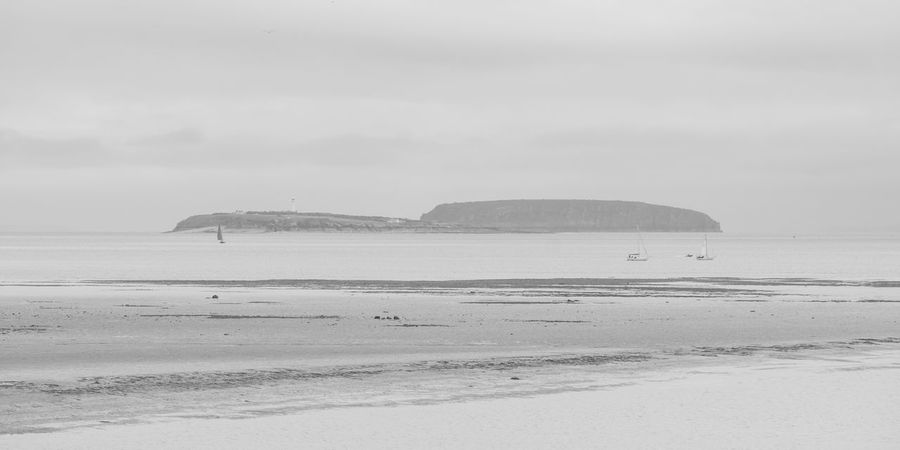 Beach Blackandwhite Cymru Day Ebb Tide FUJIFILM X-T1 Horizon Over Water Island Lighthouse Nature Outdoors Sailboat Sand Scenics Sea Sky Tranquility Wales Water Monochrome