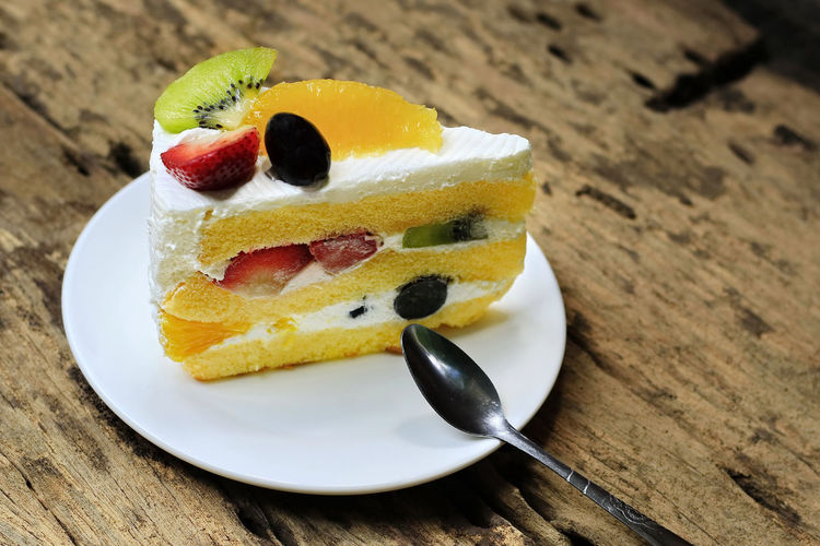 Fruity Cake on old wooden floor. Banana Breakfast Dessert Homemade Life Snack Wooden Table Cake Close-up Cream Delicious Food Food And Drink Fresh Freshness Fruity Gourmet Hummingbird Pastry Piece Plate Still Life Sweet Food Tasty White