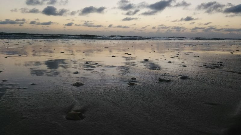 Sunset Beach Sky Dusk Sea Sand Dramatic Sky Tranquility Landscape Reflection Nature Beauty In Nature Outdoors Cloud - Sky Scenics Tranquil Scene Sun Water Horizon Over Water No People