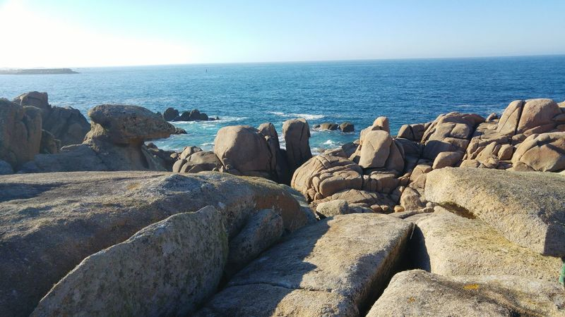 Outdoors No People Sunlight Scenics Beauty In Nature Day Clear Sky Sculpture Landscape Blue Sky Pebble Beach Liquen Pebble Tranquility Galicia, Spain Horizon Over Water Rock - Object Nature Water Beach Sea Mountain Range Mountain