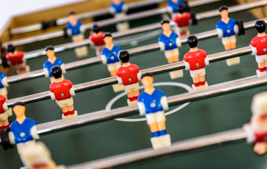Close up of foosball Table Soccer Game match figures. Football Kicker Game with blue and red figurines. Football Kicker Game Red Tablesoccer Bar Bar Games Blue Competition Figurines  Foosball Foosball Table Game Kicker Precision Rod Soccer Table Tactics Teamwork