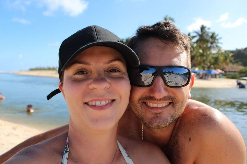 Portrait Of Smiling Mid Adult Couple At Beach