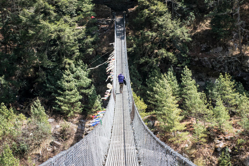 Busy on the bridge Connected By Travel Nepal Beauty In Nature Everest Base Camp Trek Footbridge Forest Nature Nepal Travel Outdoors The Way Forward Be. Ready.