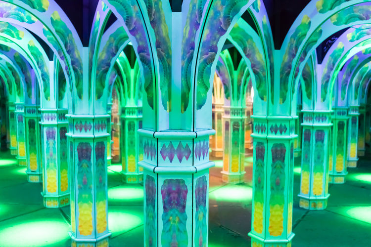 Magowan's Infinite Mirror Maze. Arched doorways & columns form the basis for this colorful mirrored maze for adults & children. Indoors  Illuminated Green Color Arch Building Glowing Multi Colored Maze Magowan's Infinite Mirror Maze Mirror Magical Indoors  Recration Backgound No People Neon Lights Amusement Park Reflection Lost Trippy Effect Wandering Disorientation San Francisco Pier 39