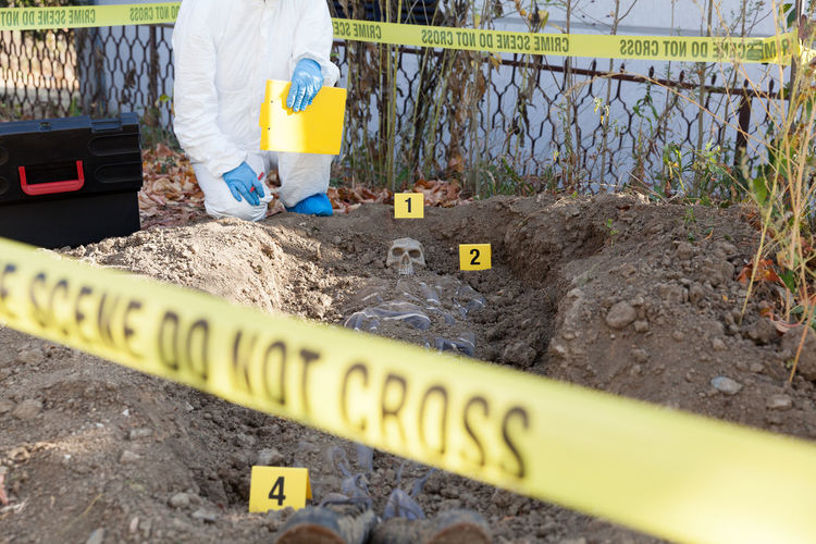 Forensic science specialist at work. Cordon Tape Occupation Protection Security Forensic Science Forensics Murder Murder Scenes Evidence Evidence Marker Crime Scene Criminal Exhumation Death Homicide Day Dna Law Enforcement Police Detective Criminologist Analyse Examine Scary Scary Places