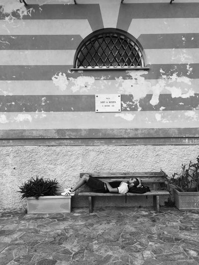Unknown Man Having A Break on a Bench Nap Break Taking Photos Blackandwhite in Portofino Italy The Tourist