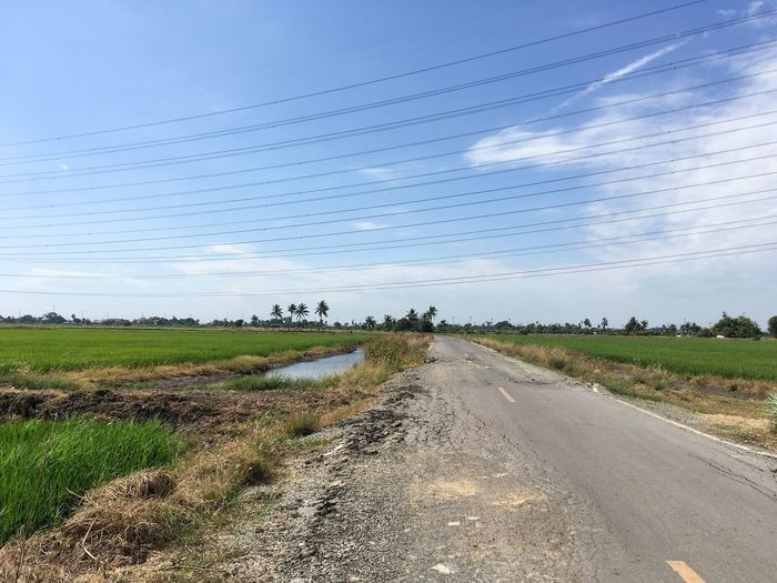Road On Field Against Sky