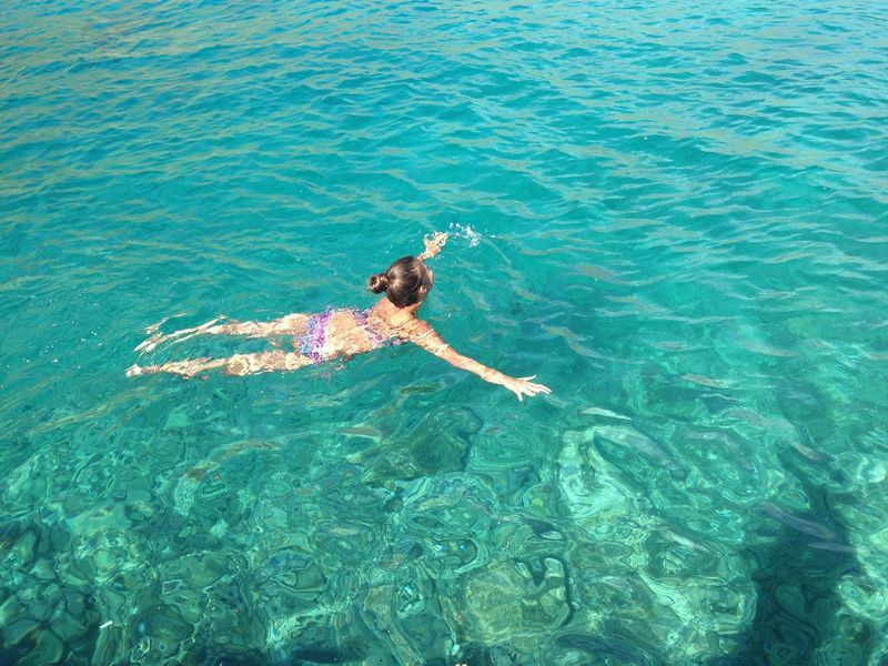 Real People High Angle View Water Sea One Person Leisure Activity Nature Day Swimming Outdoors Lifestyles Vacations Bikini Beautiful Girl Sunlight Summer Clear Water Emerald Water