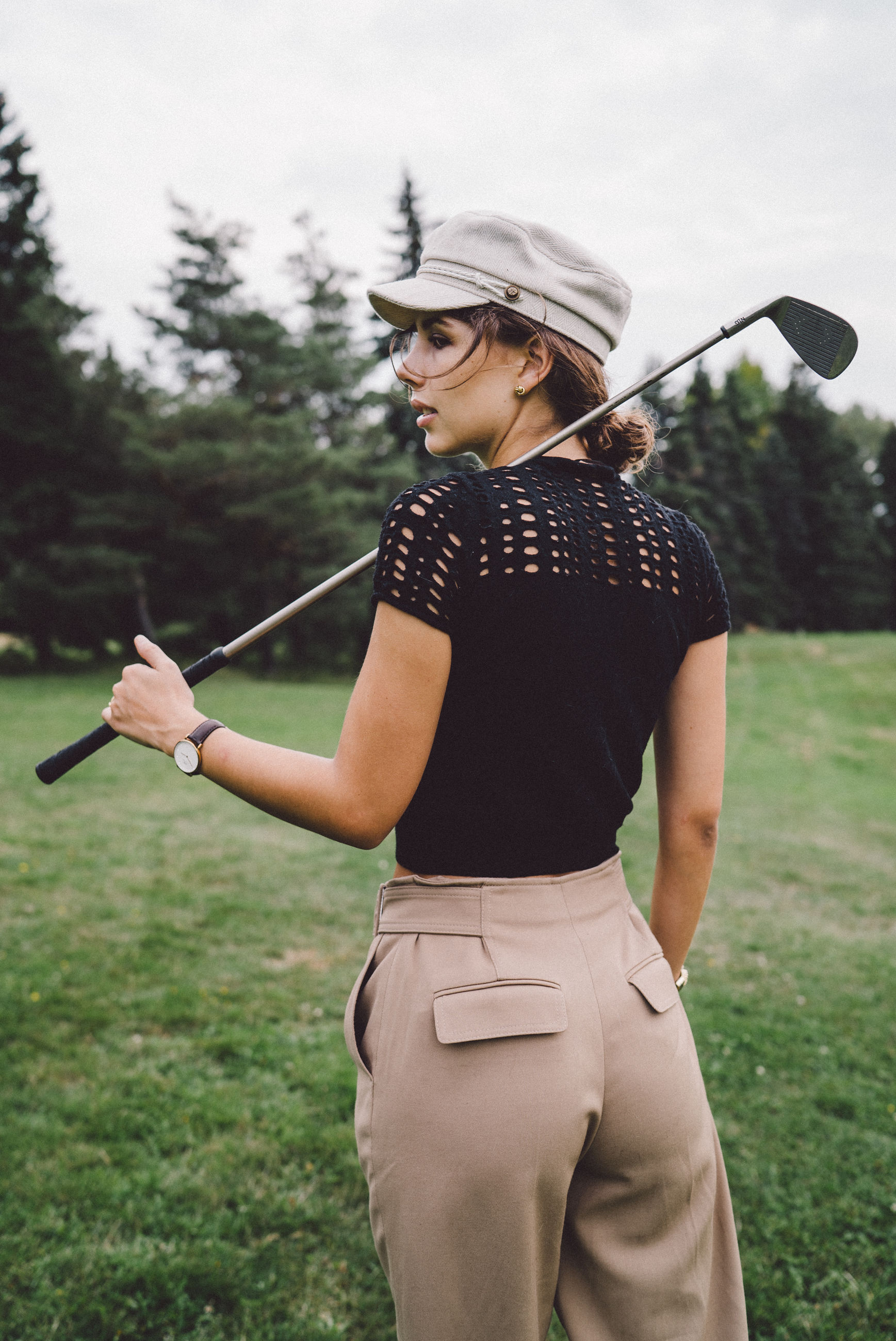 leisure activity, sport, one person, grass, golf, lifestyles, real people, golf club, three quarter length, plant, nature, activity, holding, golfer, day, young adult, field, standing, golf course, outdoors