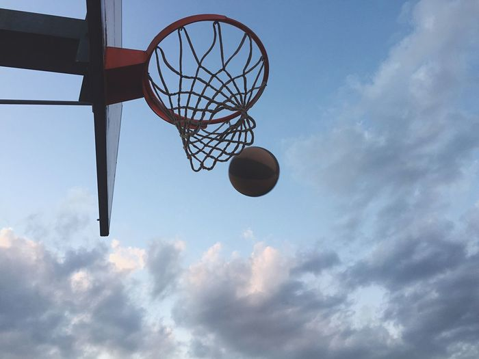 Making basket against blue sky with clouds Basketball Hoop Low Angle View Basketball - Sport Sky Sport Basketball Cloud - Sky Day No People Outdoors Court EyeEm Selects Ball Basket Basketball Game Win Energy Playing Play Basketball Sport In The City Sky And Clouds Outside Adrenaline Healthy Lifestyle