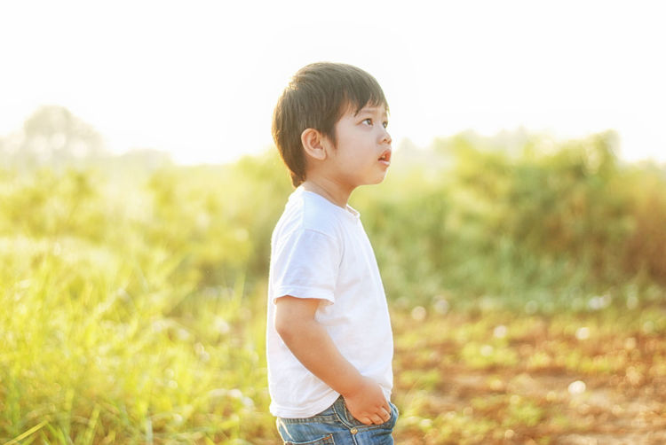 Boys Casual Clothing Childhood Day Field Grass Nature One Person Outdoors People Real People Sky Standing