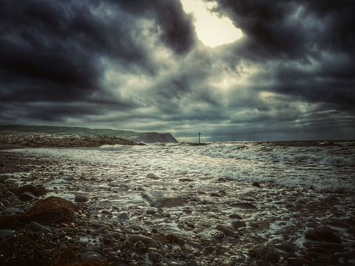 Borth... I'm looking through a whole in the sky.... Borth Borth, Wales Ceredigion Welsh Coast Mid Wales Hello Darkness My Old Friend Sea Storm Cloud Water Beach Storm Low Tide Dramatic Sky Awe Tide Atmospheric Mood Seascape Moody Sky Coast Surf Wave Cloudscape Autumn Mood