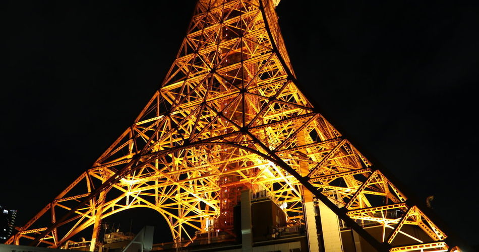 Spectacular perspective view of Tokyo Tower illuminated at night. The Tokyo Tower is a telecommunications building and also a panoramic observatory in Minato district Japan Tokyo Tokyo Tower Tokyo Tower In The Rain Tokyo Tower And Mount Fuji Tokyo Tower Night View Architecture Building Exterior Built Structure City Connection Illuminated Lighting Equipment Low Angle View Metal Nature Night No People Outdoors Sky Steel Tall - High Technology Tokyo Tower 2017 Tokyo Tower Jack Tourism Tower Travel Destinations