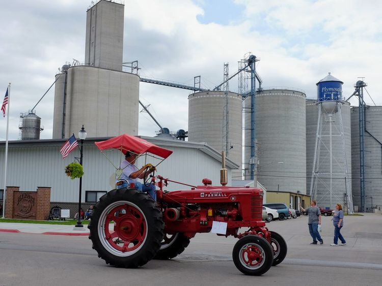 Village of Plymouth 125th Anniversary Celebration August 13, 2017 Plymouth, Nebraska American Life Americans Camera Work EventPhotography FUJIFILM X100S MidWest Nebraska Plymouth, Nebraska Small Town America Storytelling Summertime Tractor Agricultural Machinery Architecture Building Exterior Built Structure Cloud - Sky Day Farmall Tractor Fujifilm_xseries Industry Men Occupation One Person Outdoors Parade Practicing Photography Real People Sky Small Town Stories Streetphotography Working
