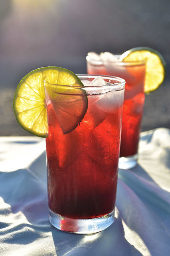 Cold iced tea made from hibiscus flower petal tea in hot desert setting