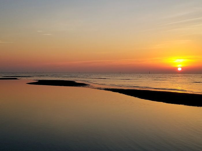 Sunrise Sun Beach Sea Horizon Over Water Landscape Reflection Water Sky Tranquility Blue Sunny Tranquil Scene Sunlight Beauty In Nature Idyllic Tourism Scenics Dusk Nature Beach low tide