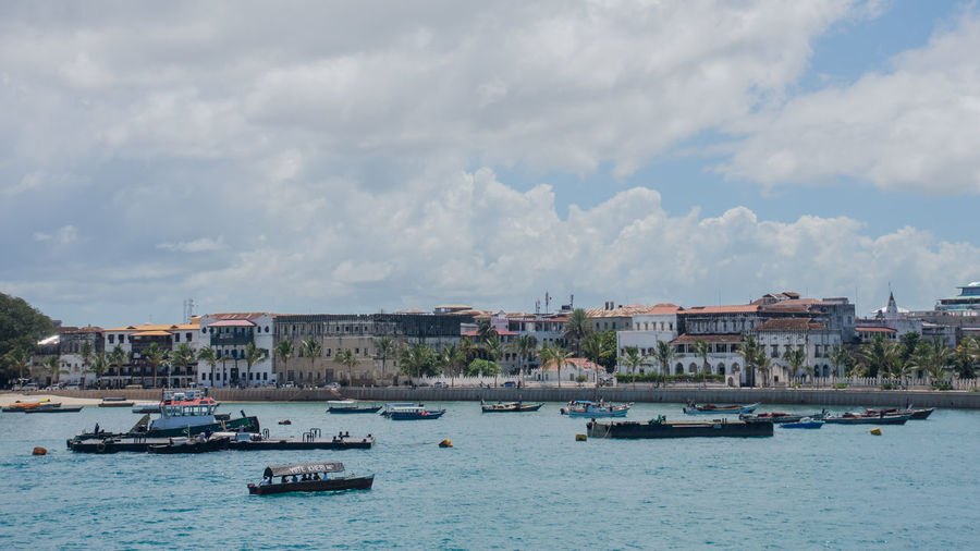 Boats In Sea Against Buildings In City