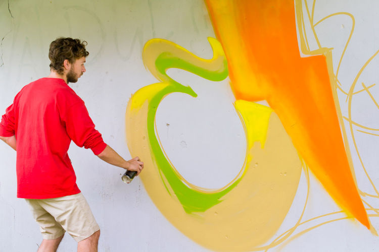 Casual Clothing Colorful Creativity Fantasy Graffiti Graffiti Art Graffiti Wall Guy Hands At Work Modern Art Mural Mural Art Painting Art Pattern, Texture, Shape And Form Person Street Photography Streetart Wall Art Young Adult Youth Of Today