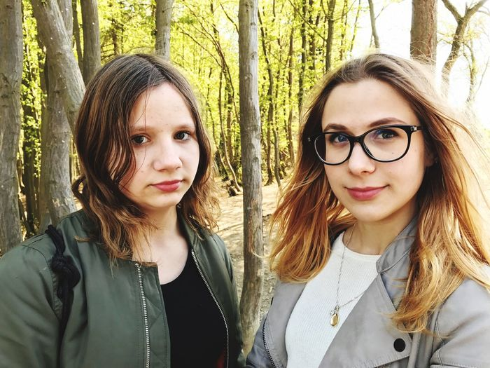 EyeEm Selects Looking At Camera Portrait Day Real People Tree Trunk Tree Front View Eyeglasses  Outdoors Smiling Young Adult Young Women One Person Nature People Adult Portrait Of A Woman Women Makeup Blond Hair Girls