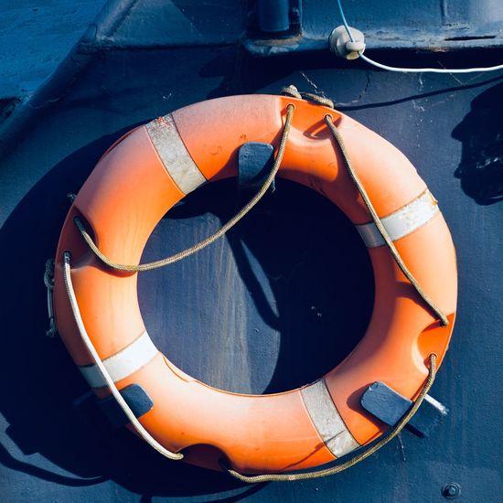 Orange lifebuoy on the boat