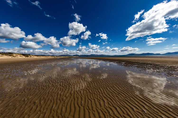 Reflections in the sand Newborough Beach Arid Climate Beauty In Nature Blue Climate Cloud - Sky Day Desert Environment Horizon Over Land Land Landscape Nature New Borough No People Non-urban Scene Outdoors Remote Sand Scenics - Nature Semi-arid Sky Tranquil Scene Tranquility Water
