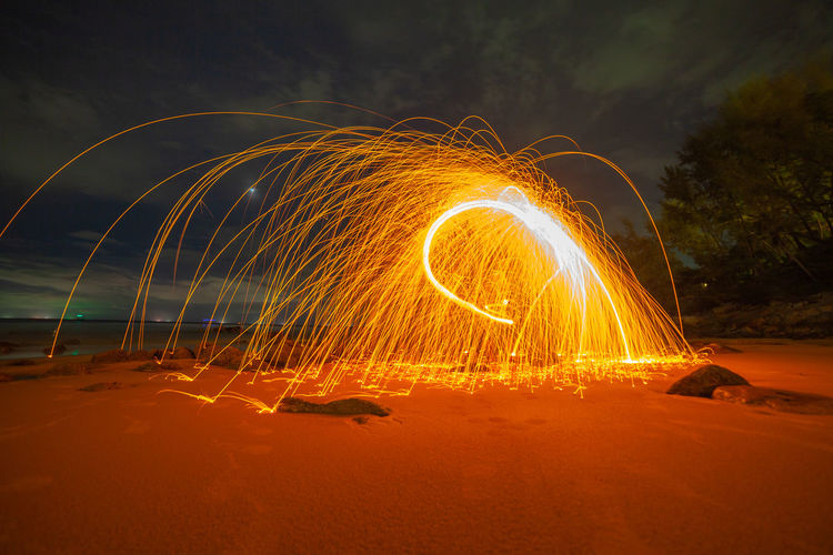 cool burning steel wool art fire work photo experiments on the beach at sunset Art Firworks, Firework, Sunset, Beach, Nature, Red, Spinning Light, Twight, Sky, Fire, Reflect, Sea, Star, Jewish, David, Symbol, White, Israel, Holiday, Background, Hebrew, Blue, Religion, Judaism, Decoration, Old, Art, Religious, Jew, Gold, Israeli, Ornament, Sign, Judaic, Isolated, Cemetery, Hexagram, Memorial, Star Of David, Vintage, Texture, Ancient Heart, Hot, Hot, Hot Steel Wool, Night Long Exposure Motion Wire Wool Illuminated Land Glowing Blurred Motion Burning Orange Color Fire Beach Sand Nature Fire - Natural Phenomenon Water Sky Outdoors Event Sparks