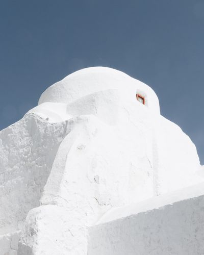 Low angle view of whitewashed building against sky