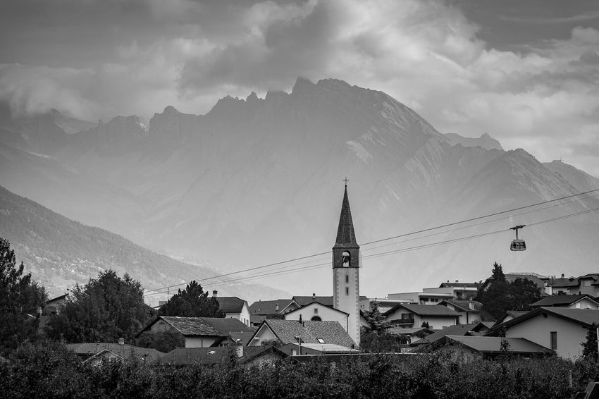 Picture of a Riddes´s town Church Riddes Switzerland Alps Telechair Architecture Belief Blac And Withe Building Building Exterior Built Structure City Cloud - Sky Day Mountain Mountain Range Nature No People Outdoors Place Of Worship Religion Scenics - Nature Sky Spirituality TOWNSCAPE