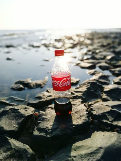 Coca-cola Beach Sea Water Reflections Water Flowing Water Ocean Ocean View Rocks Rocks And Water Colourful Nature Colourful Nature Nature Photography Daylight Sunlight Sparkling Sparkling Water HuaweiP9 First Eyeem Photo Art People And Places Focus Object Finding New Frontiers Adapted To The City Uniqueness Break The Mold TCPM Art Is Everywhere EyeEmNewHere Perspectives On Nature