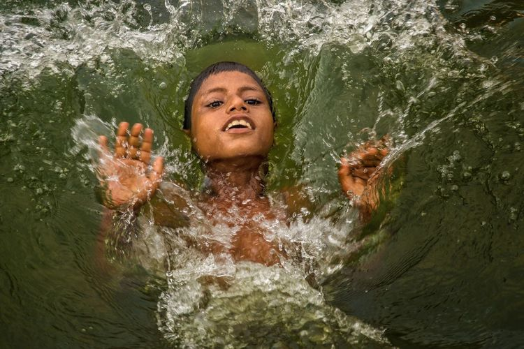 Woman swimming in river
