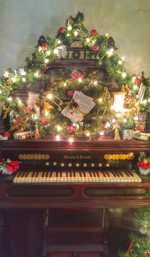 Piano at The Baker House Christmas Christmas Tree Celebration Tradition Christmas Decoration Indoors  Illuminated Baker House The Baker House Historical No People Christmas Ornament Tree Architecture Day Historical Building Florida Florida History Piano Piano Keys Garland Antique Piano Key Wood Wood - Material