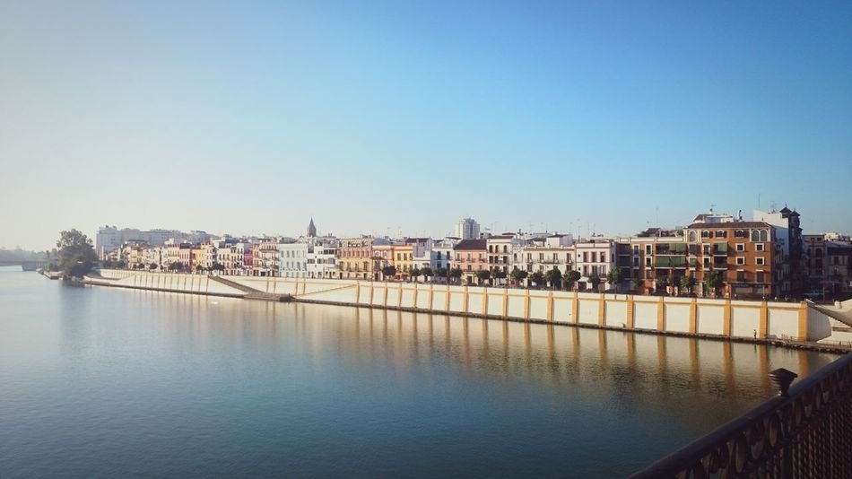 Architecture Built Structure Water Building Exterior Clear Sky City River Bridge - Man Made Structure Waterfront Riverbank City Life ByTheRiver Vanishing Point Strolling Around Sevilla